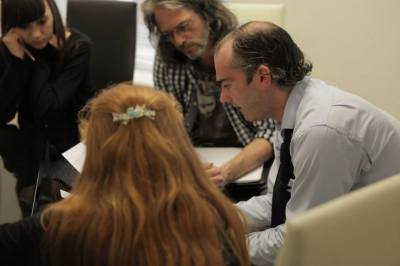 Rob Smith and Mike Martin discussing the design breakdown of their script